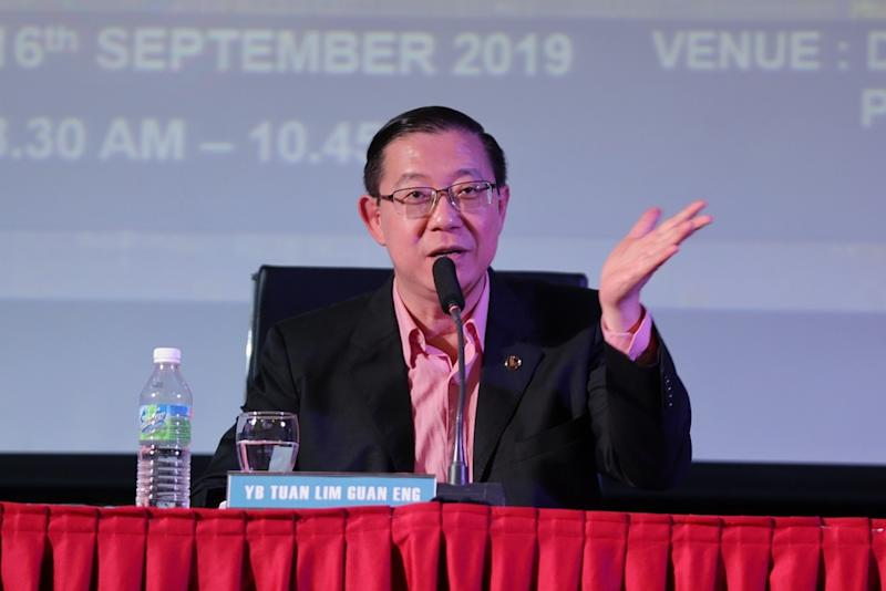 Finance Minister Lim Guan Eng said that it was unfair to accuse PH of delay tactics when it must deal with issues such as 1MDB's debt and the National Higher Education Corporation's repayment arrears.. — Picture by Ahmad Zamzahuri
