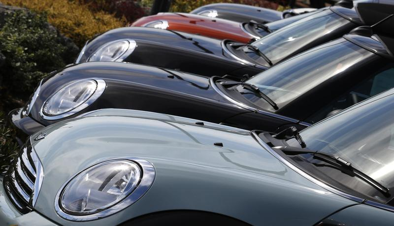 New Mini cars are parked outside a Mini dealership in Brighton in southern England