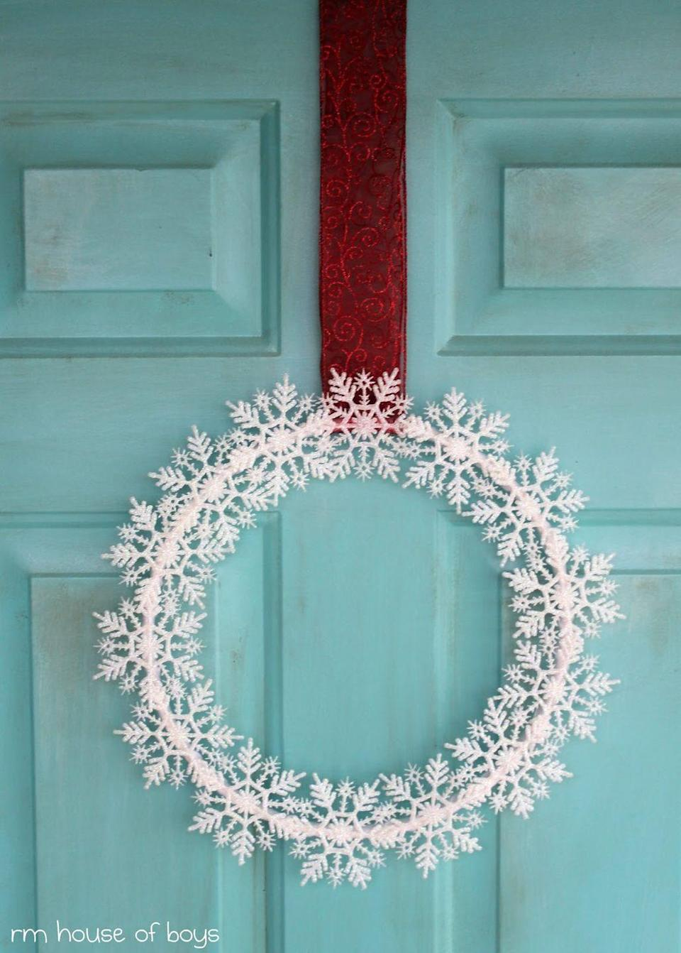 "<p>Hang a wreath full of snowflakes from a bold ribbon for a color-block effect on an icy blue door (or any color door, really).<br></p><p><em><a href=""http://rmhouseofnoise.blogspot.com/2011/11/snowflakes-keep-falling-on-my-head.html"" rel=""nofollow noopener"" target=""_blank"" data-ylk=""slk:Get the tutorial at RM House of Boys »"" class=""link rapid-noclick-resp"">Get the tutorial at RM House of Boys »</a></em><br></p>"