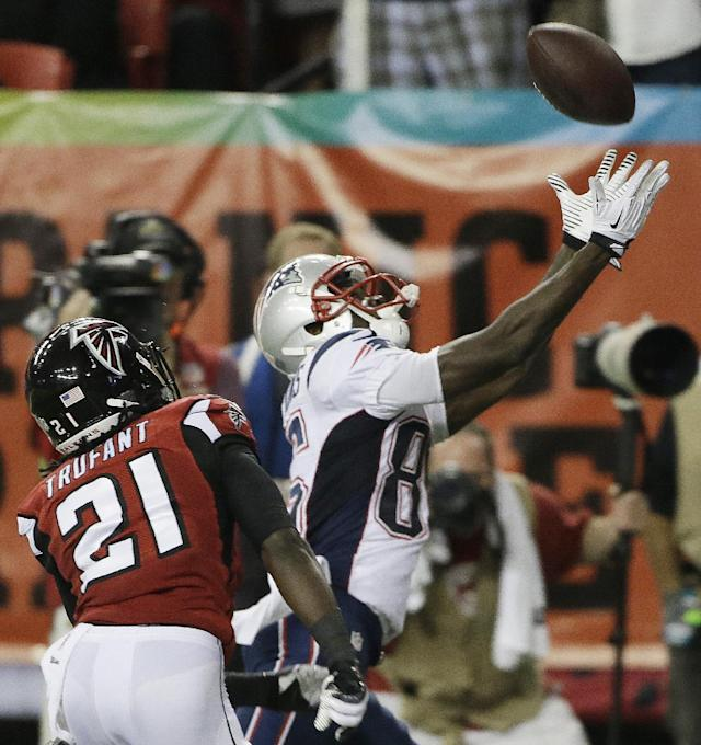 New England Patriots wide receiver Kenbrell Thompkins (85) makes a catch for a touchdown against Atlanta Falcons cornerback Desmond Trufant (21) during the second half of an NFL football game, Sunday, Sept. 29, 2013, in Atlanta. (AP Photo/John Bazemore)
