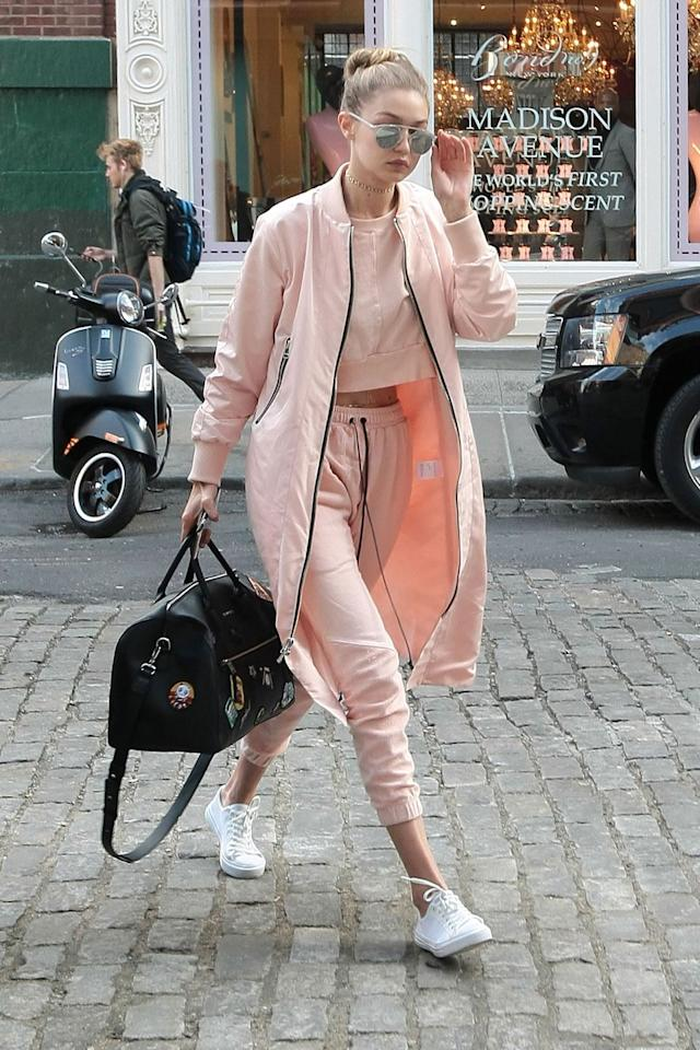 <p>Hadid looked spring ready as she stepped out in pink athleisure separates and Gentle Monster metallic aviators. </p>