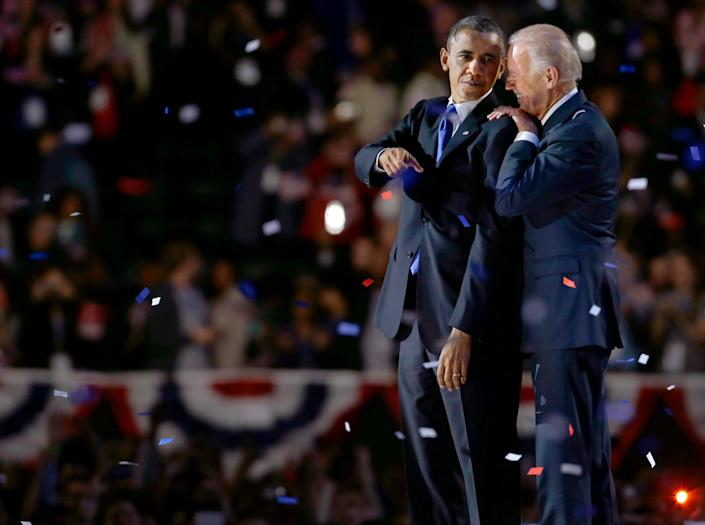 Vice President Joe Biden, right, talks to President Barack Obama at their election night party Wednesday, Nov. 7, 2012, in Chicago. President Obama defeated Republican challenger former Massachusetts Gov. Mitt Romney. (AP Photo/M. Spencer Green)