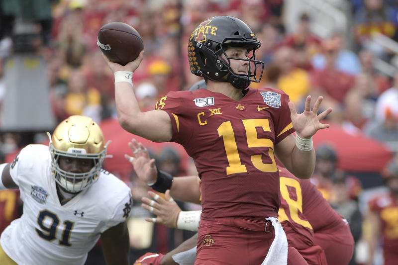Iowa State quarterback Brock Purdy (15) throws a pass in front of Notre Dame defensive lineman Adetokunbo Ogundeji (91) during the first half of the Camping World Bowl NCAA college football game Saturday, Dec. 28, 2019, in Orlando, Fla. (AP Photo/Phelan M. Ebenhack)