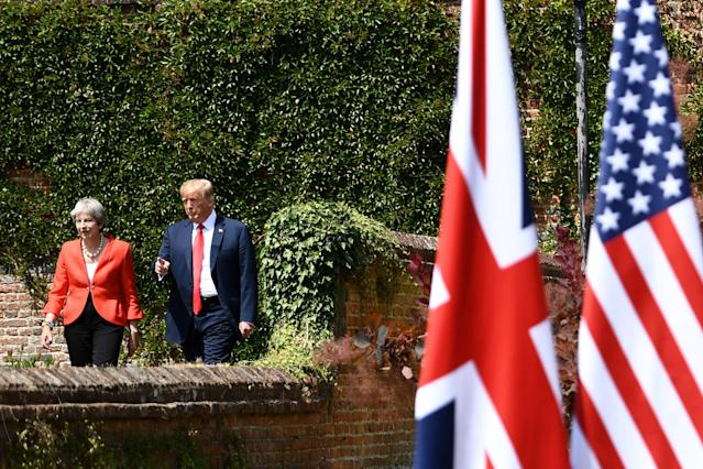 <p>President Donald Trump (R) and Britain's Prime Minister Theresa May walk to hold a joint press conference following their meeting at Chequers, the prime minister's country residence, near Ellesborough, northwest of London on July 13, 2018 on the second day of Trump's U.K. visit. (Photo: Brendan Smialowski/AFP/Getty Images) </p>