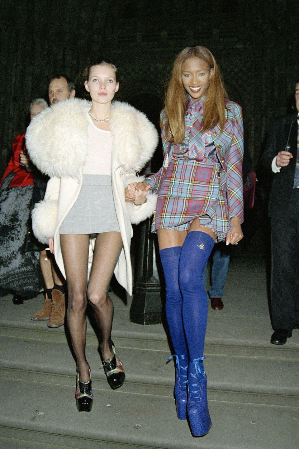 <p>Supermodel BFFs Kate Moss and Naomi Campbell had so many iconic looks in the '90s, but we'll never forget when Campbell stepped out in these bright blue platform boots by Vivienne Westwood. </p>