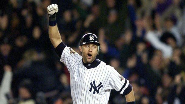 PHOTO: New York Yankees' Derek Jeter celebrates after hitting game winning home run in 10th inning against Arizona Diamondbacks in 2001 World Series. (NY Daily News via Getty Images)