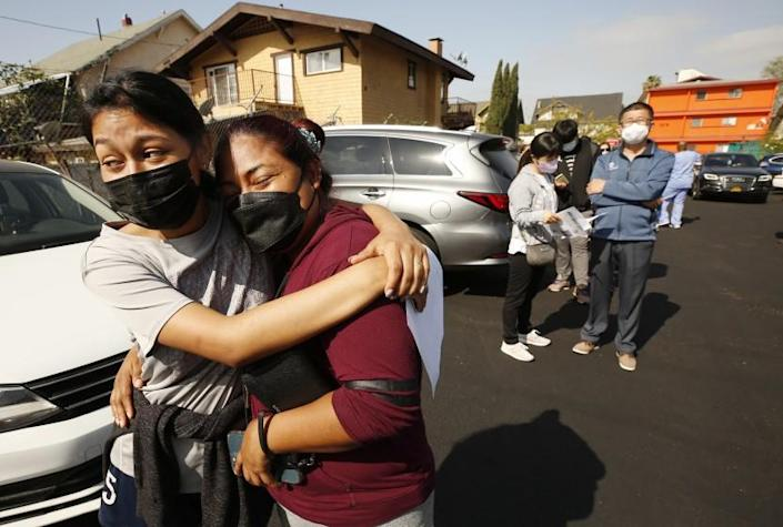 LOS ANGELES, CA - APRIL 20: Jeymy Mendoza, 16, hugs her mother Maria Jimenez, 34, as they wait in line to receive the Pfizer Covid-19 vaccination at a new, walk-up mobile COVID-19 clinic launched today to provide the Pfizer COVID-19 vaccine to underserved communities in Los Angeles. The walk-up clinic was presented by Councilmember Mark Ridley-Thomas in partnership with CHA Hollywood Presbyterian Medical Center (CHA HPMC) and the Southern California Eye Institute (SCEI). The Mobile Vaccine Clinic at 1819 S. Western Avenue will be open every Tuesday starting April 20 through May 25 providing free vaccines to community members who are eligible per LA County Department of Public Health (LAC DPH) vaccine distribution guidelines as they partnered with Charles R. Drew University of Medicine and Science to provide student volunteers for on-site registration allowing for walk-up appointments for community members and further ensuring vaccine access in our hardest-hit communities. Los Angeles on Tuesday, April 20, 2021 in Los Angeles, CA. (Al Seib / Los Angeles Times).