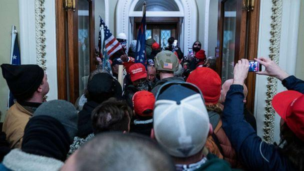 PHOTO: Supporters of President Donald Trump press through the door to the House chamber after breaching Capitol security in Washington, D.C., Jan. 6, 2021. (Jim Lo Scalzo/EPA via Shutterstock)