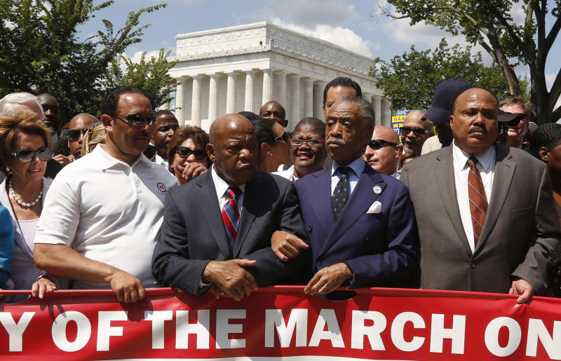 Rev. Al Sharpton (2nd R) links arms with Rep. John Lewis (D-GA) next to Martin Luther King III (R) as they begin to march during the 50th anniversary of the 1963 March on Washington for Jobs and Freedom at the Lincoln Memorial in Washington August 24, 2013. (Photo: Kevin Lamarque/Reuters)