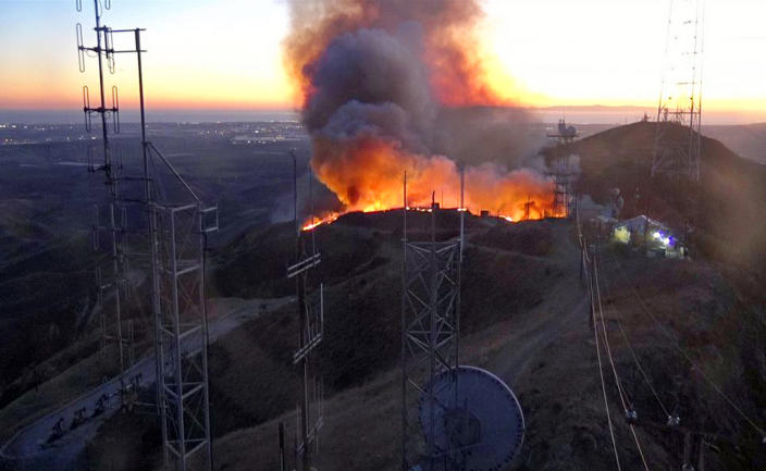 This remote-camera photo posted on the Ventura County Fire Department's Twitter page shows the beginning of the Maria fire at an antenna farm atop South Mountain near Santa Paula, Calif., Thursday evening, Oct. 31, 2019. (Ventura County Fire Department via AP)