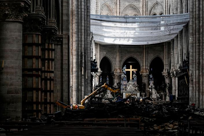 Rubble and the cross are pictured under a protective net inside Notre Dame de Paris Cathedral, May 15, 2019 in Paris. (Photo: Philippe Lopez/Pool via AP)