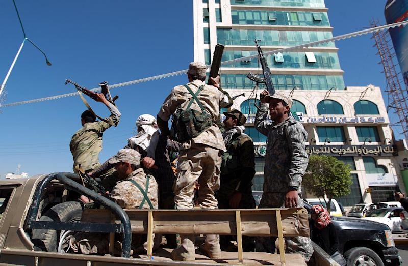 Shiite Huthi fighters drive through the Yemeni capital Sanaa on February 11, 2015 (AFP Photo/Mohammed Huwais)