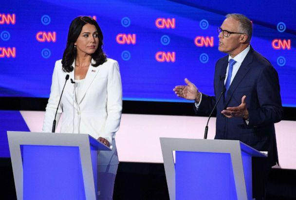 PHOTO: Democratic presidential hopefuls US Representative for Hawaii's 2nd congressional district Tulsi Gabbard (L) and Governor of Washington Jay Inslee (R) speak during the second round of the second Democratic primary debate. (Jim Watson/AFP/Getty Images)