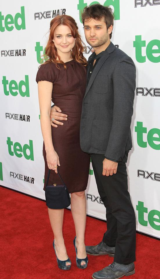 "HOLLYWOOD, CA - JUNE 21: Actress Alexandra Breckenridge (L) and her guest attend the Premiere Of Universal Pictures' ""Ted"" at Grauman's Chinese Theatre on June 21, 2012 in Hollywood, California.  (Photo by Frederick M. Brown/Getty Images)"