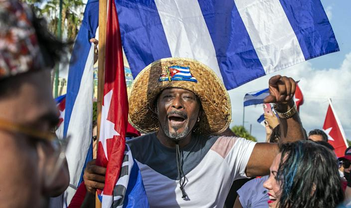 Cuban exiles rally at Versailles Restaurant in Miami's Little Havana in support of protesters in Cuba as thousands of Cubans took to the streets in rare protests Sunday, July 11, 2021, to complain about a lack of freedom and a worsening economic situation.