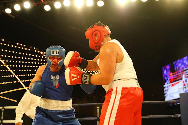 <p>Jerry Packtor (red) connects against opponent Mark Sinatra (blue) in Super Heavyweight action during the NYPD Boxing Championships at the Hulu Theater at Madison Square Garden on March 15, 2018. (Gordon Donovan/Yahoo News) </p>