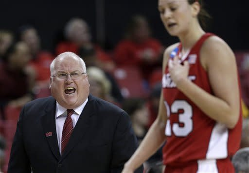 Marist head coach Brian Giorgis, left, directs guard Elizabeth Beynnon during the second half of a first-round game against Michigan State in the women's NCAA college basketball tournament in College Park, Md., Saturday, March 23, 2013. Michigan State won 55-47. (AP Photo/Patrick Semansky)