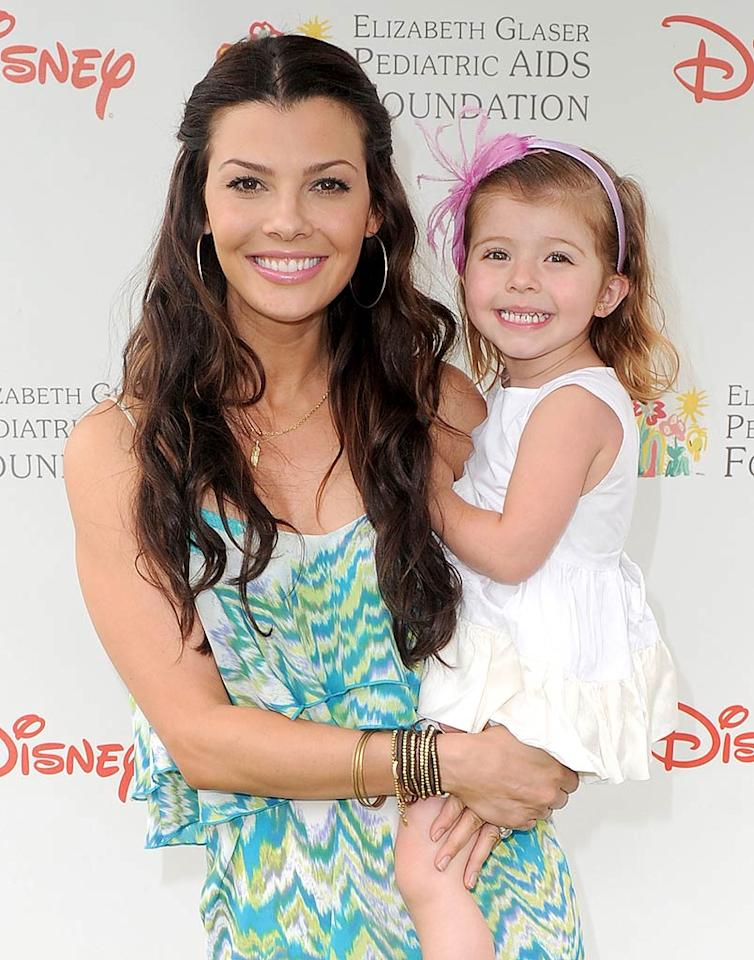 "Say ""cheese!"" Little Estela Ines Monteverde is the spitting image of her beautiful mom Ali Landry. Alberto E. Rodriguez/<a href=""http://www.gettyimages.com/"" target=""new"">GettyImages.com</a> - June 13, 2010"