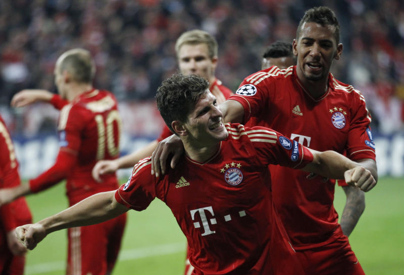 Bayern's Mario Gomez, center, celebrates with his teammate David Alaba after scoring his side's 2nd goal during the Champions League first leg semifinal soccer match between Bayern Munich and Real Madrid in Munich, southern Germany, Tuesday, April 17, 2012. (AP Photo/Matthias Schrader)