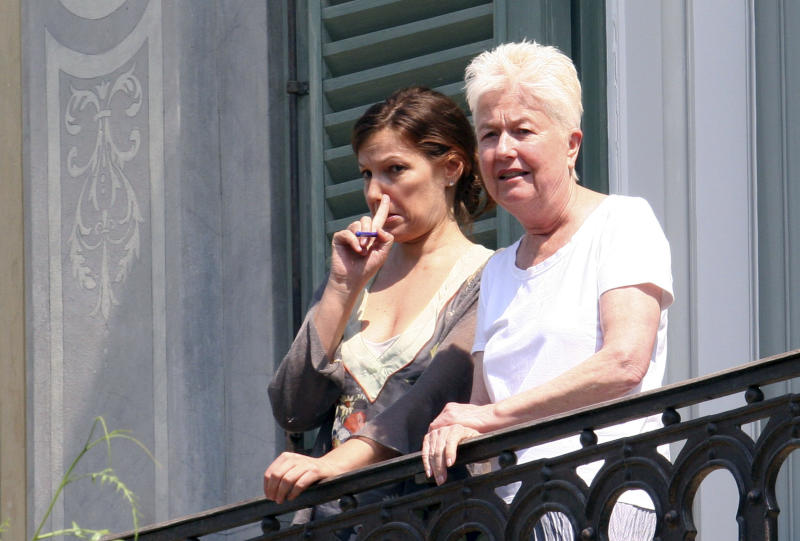 """Eleanor Coppola, right, wife of filmmaker Francis Ford Coppola stands by an unidentified woman as she looks from the balcony of  the historic """"Palazzo Margherita"""" prior to the wedding of her daughter Sofia Coppola, in the southern Italian town of Bernalda, Saturday, Aug. 27, 2011. Filmmaker Sofia Coppola is going back to her roots, getting married Saturday in the southern Italian town where her great-grandfather was born. Coppola is marrying Thomas Mars, lead singer of the French rock band Phoenix and the father of their two young daughters. The ceremony will take place in the garden of a historic palazzo that her famous father, Francis Ford Coppola, has renovated in the center of the Italian town of Bernalda, according to mayor Leonardo Chiruzzi. The senior Coppola plans to turn it into a luxury boutique hotel. (AP Photo/Donato Fasano)"""