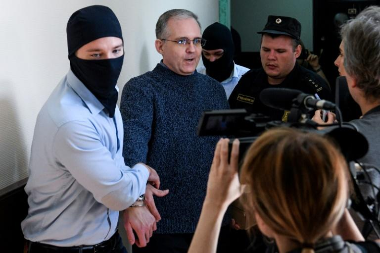Whelan arrived at court handcuffed and escorted by two guards, one wearing a black mask, the other in plain clothes (AFP Photo/Kirill KUDRYAVTSEV)