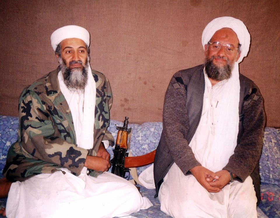 Osama bin Laden (L) sits with his adviser Ayman al-Zawahiri, an Egyptian linked to the al Qaeda network, during an interview with Pakistani journalist Hamid Mir (not pictured) at an undisclosed location in Afghanistan. The date is unknown. (Visual News/Getty Images)