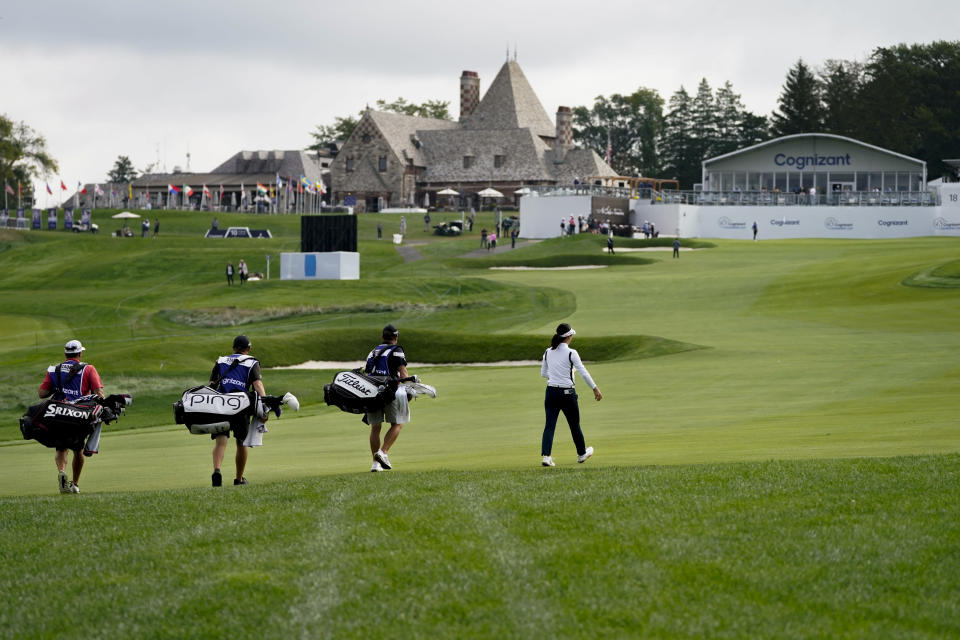 So Yeon Ryu, of South Korea, right, walks up the 18th fairway in the first round of the Cognizant Founders Cup LPGA golf tournament, Thursday, Oct. 7, 2021, in West Caldwell, N.J. (AP Photo/John Minchillo)
