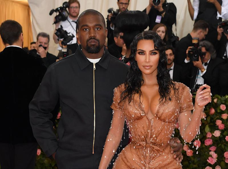"Kim Kardashian and Kanye West arrive for the 2019 Met Gala at the Metropolitan Museum of Art on May 6, 2019, in New York. - The Gala raises money for the Metropolitan Museum of Arts Costume Institute. The Gala's 2019 theme is Camp: Notes on Fashion"" inspired by Susan Sontag's 1964 essay ""Notes on Camp"". (Photo by ANGELA WEISS / AFP) (Photo credit should read ANGELA WEISS/AFP/Getty Images)"