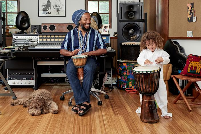 "<div class=""caption""> Musician Ziggy Marley in his home recording studio in L.A.'s Toluca Lake neighborhood with son Isaiah and dog Romeo. The room was originally a movie screening room for the previous owners. </div>"