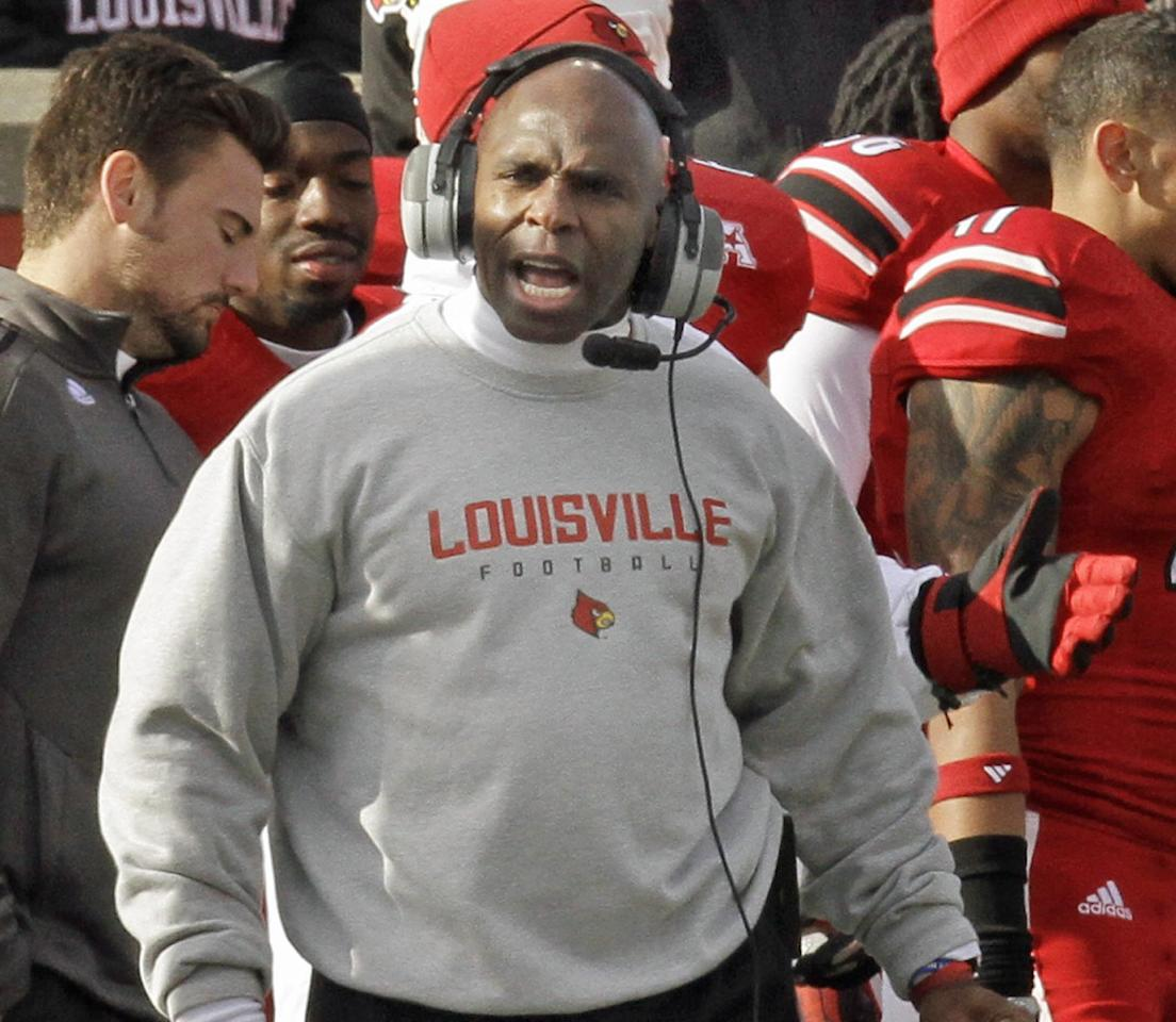 Louisville coach Charlie Strong shouts instructions to his team late in the fourth quarter of an NCAA college football game against Memphis in Louisville, Ky., Saturday, Nov. 23, 2013. (AP Photo/Garry Jones)