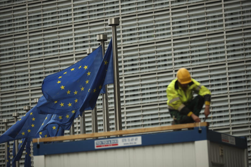A construction worker works outside European Commission headquarters in Brussels, Friday, Oct. 4, 2019. British Brexit negotiator David Frost is continuing technical negotiations at EU headquarters on Friday, seeking ways to find a breakthrough in the stalled UK-EU divorce negotiations. (AP Photo/Francisco Seco)