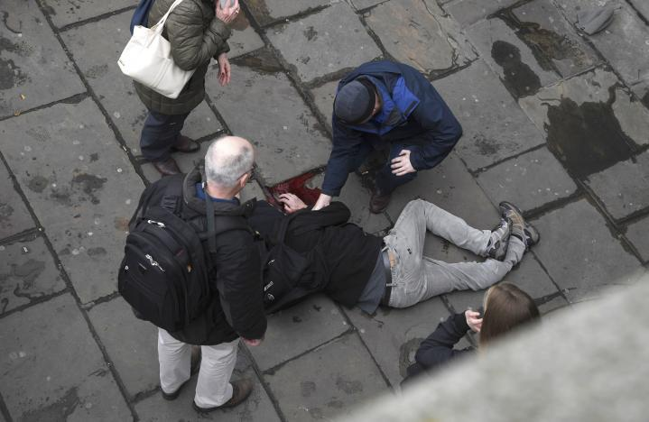 An injured man is assisted after an incident on Westminster Bridge in London, Britain March 22, 2017. REUTERS/Toby Melville