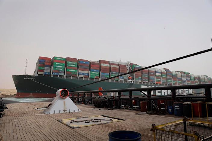This photo released by the Suez Canal Authority on Thursday, March 25, 2021, shows the Ever Given, a Panama-flagged cargo ship, after it become wedged across the Suez Canal and blocking traffic in the vital waterway from another vessel.