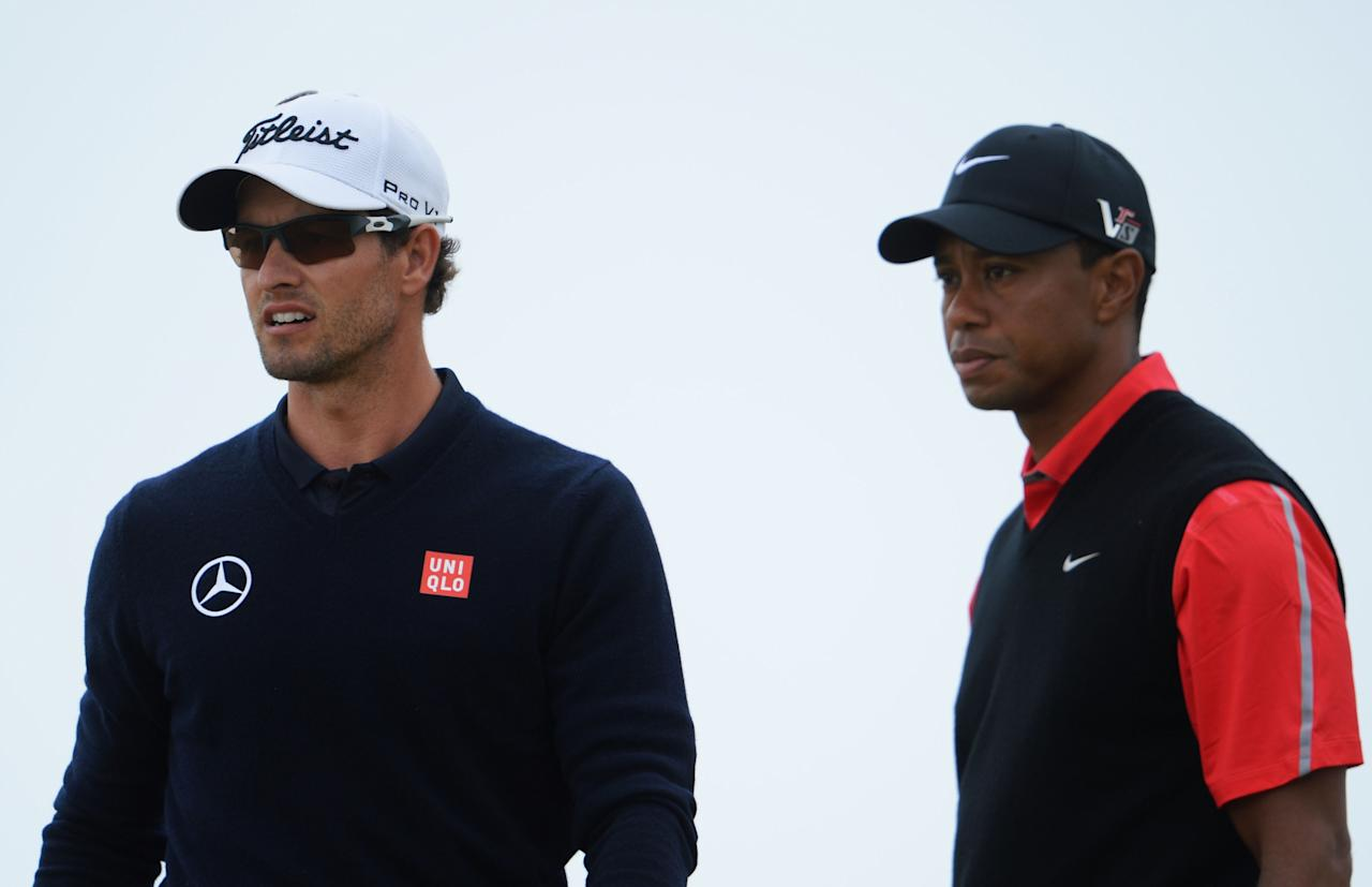 GULLANE, SCOTLAND - JULY 21: Adam Scott of Australia and Tiger Woods of the United States during the final round of the 142nd Open Championship at Muirfield on July 21, 2013 in Gullane, Scotland. (Photo by Stuart Franklin/Getty Images)