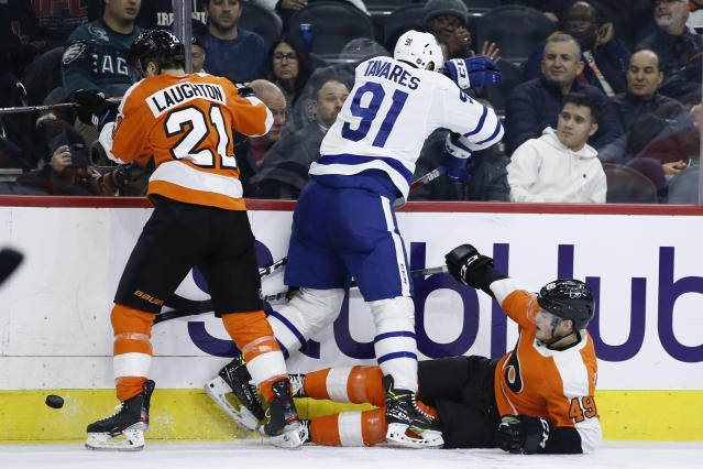 Toronto Maple Leafs' John Tavares (91) collides with Philadelphia Flyers' Joel Farabee (49) and Scott Laughton (21) during the third period of an NHL hockey game, Tuesday, Dec. 3, 2019, in Philadelphia. (AP Photo/Matt Slocum)