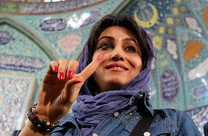 Iranian officials said millions had cast their ballots and estimated voter turnout at 60 percent (AFP Photo/Atta Kenare)