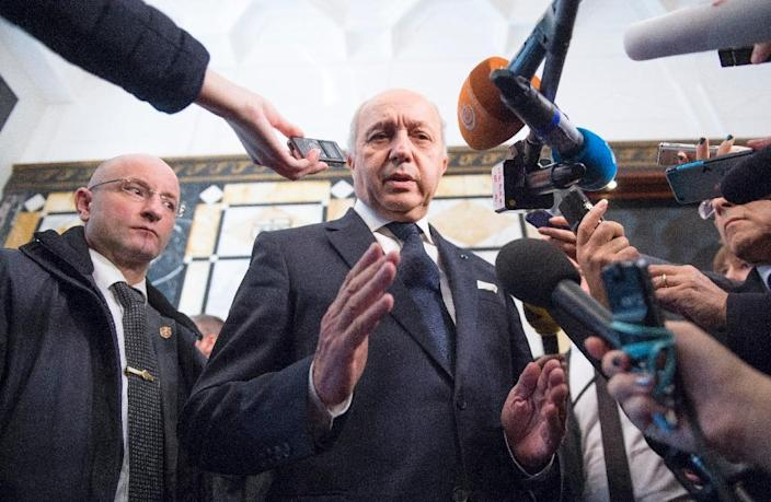 A transitional government is part of an ambitious plan for war-ravaged Syria, agreed upon in Vienna November 14 by international diplomats including French Foreign Minister Laurent Fabius, but seen as 'unrealistic' by some in Syria's opposition (AFP Photo/Joe Klamar)