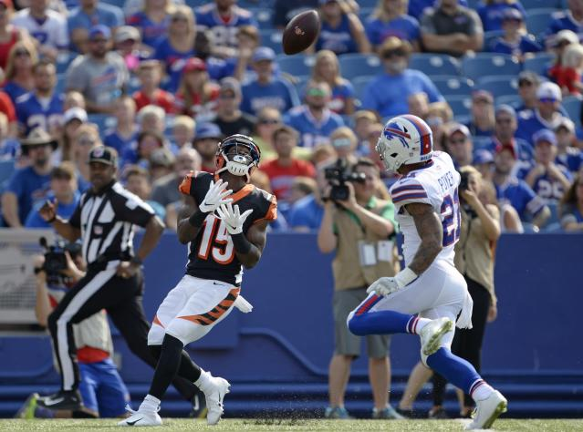 Cincinnati Bengals wide receiver John Ross (15) catches a pass in front of Buffalo Bills' Jordan Poyer (21) during the first half of a preseason NFL football game Sunday, Aug. 26, 2018, in Orchard Park, N.Y. Ross scored a touchdown on the play. (AP Photo/Adrian Kraus)
