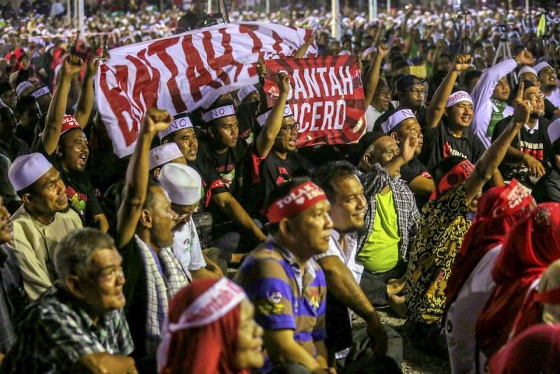 Umno and PAS members, and NGOs, attend an ICERD protest in Kampung Gajah, Perak November 17, 2018. — Picture by Farhan Najib