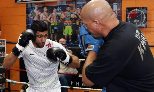 Khan's trainer Virgil Hunter (right) has urged him not to retire from boxing (Peter Byrne/PA)