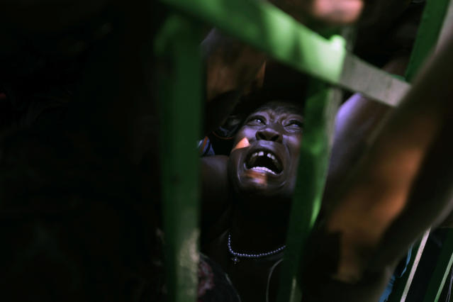 <p>A woman is crushed in a crowd of people waiting for food rations in the aftermath of the Jan. 12 earthquake in Port-au-Prince, Thursday, Jan. 28, 2010. (Photo: Ramon Espinosa/AP) </p>