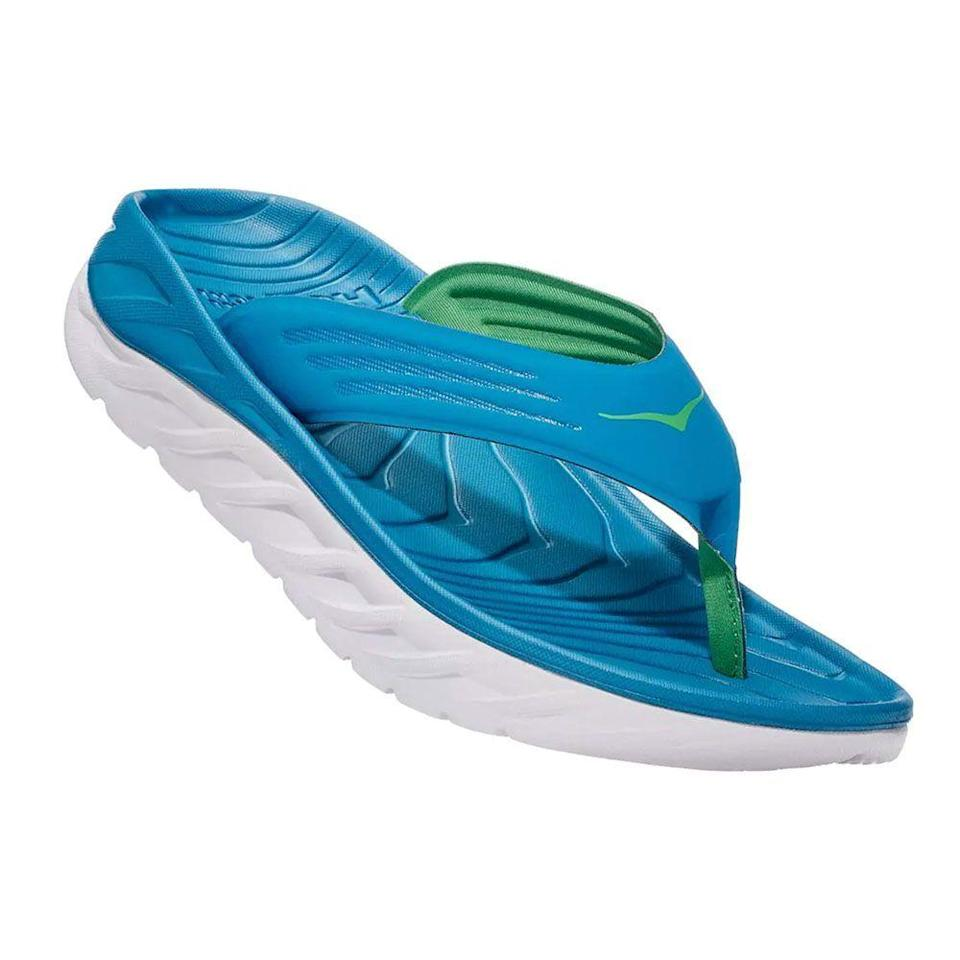 "<p><strong>Hoka One One</strong></p><p>hokaoneone.com</p><p><strong>$12.50</strong></p><p><a href=""https://go.redirectingat.com?id=74968X1596630&url=https%3A%2F%2Fwww.hokaoneone.com%2Fmens-recovery-sandals%2Fora-recovery-flip%2F1099675.html%3Fdwvar_1099675_color%3DBSGB&sref=https%3A%2F%2Fwww.bestproducts.com%2Ffitness%2Fequipment%2Fg362%2Fhealth-and-fitness-gift-ideas%2F"" rel=""nofollow noopener"" target=""_blank"" data-ylk=""slk:Shop Now"" class=""link rapid-noclick-resp"">Shop Now</a></p><p>Tired runners' feet will flip for these recovery sandals. Walking on that oversized midsole feels like you're stepping on pillows — a welcome respite after pounding the pavement. They may not be scientifically proven to speed up recovery, but whose feet couldn't use a little extra TLC?</p>"
