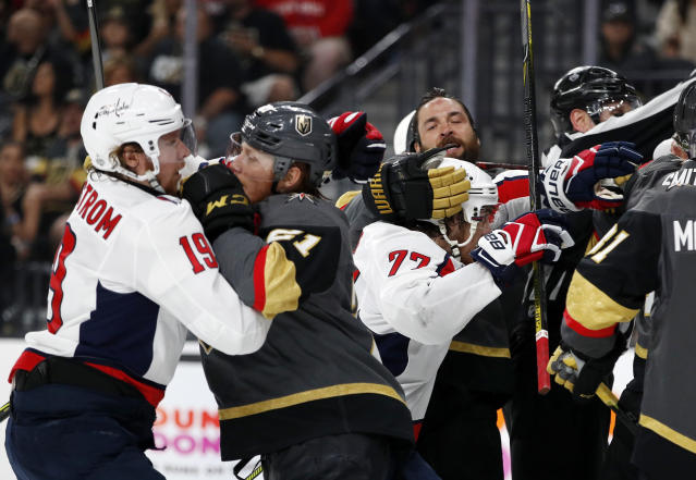 Vegas Golden Knights and Washington Capitals scuffle during the first period in Game 2 of the NHL hockey Stanley Cup Finals on Wednesday, May 30, 2018, in Las Vegas. (AP Photo/John Locher)