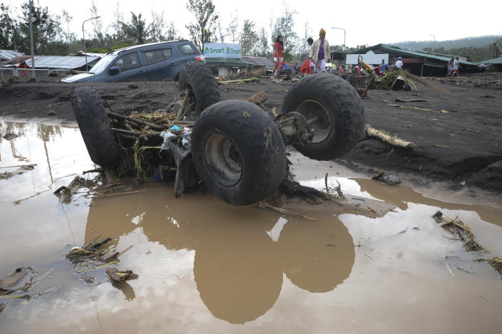An All-Terrain Vehicle is toppled by strong winds and floods from Typhoon Goni as it hits Daraga, Albay province, central Philippines, Sunday, Nov. 1, 2020. The super typhoon slammed into the eastern Philippines with ferocious winds early Sunday and about a million people have been evacuated in its projected path, including in the capital where the main international airport was ordered closed. (AP Photo)