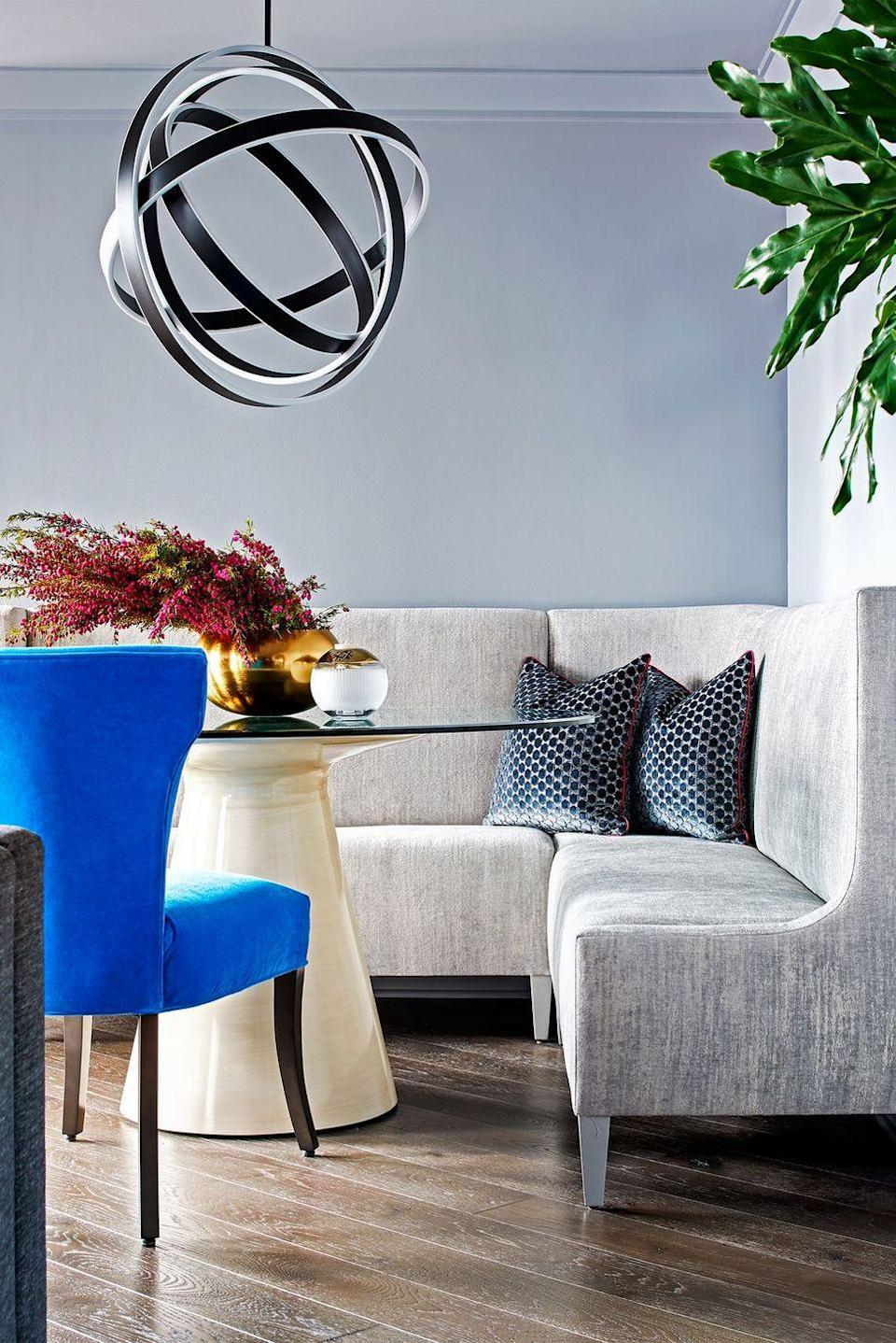 """<p>Interior designer <a href=""""https://www.shakoorinc.com/"""" rel=""""nofollow noopener"""" target=""""_blank"""" data-ylk=""""slk:Erin Shakoor"""" class=""""link rapid-noclick-resp"""">Erin Shakoor</a> doubled the seating in this dining nook with a banquette. """"A banquette allows you to sit longer, more comfortably—is and with more people,"""" she tells us. Adding pillows helps set the move even further. </p>"""
