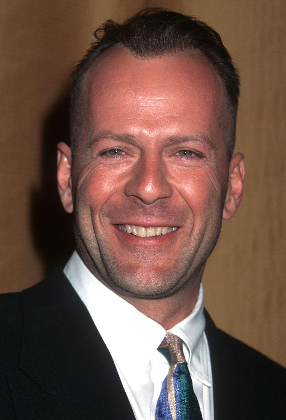 <p>You may be more familiar with a bald Bruce Willis, but when the actor first got his start as John McClane in <em>Die Hard, </em>he was sporting a full(ish) head of brown hair.</p>