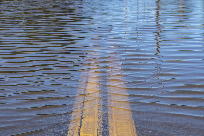 Closeup of high water flooding on neighborhood street.