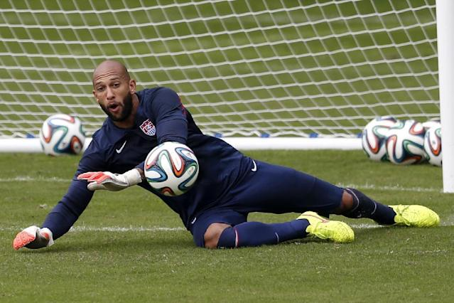 United States' goalkeeper Tim Howard dives at a shot during a training session at the Sao Paulo FC training center in Sao Paulo, Brazil, Wednesday, June 11, 2014. The U.S. will play in group G of the 2014 soccer World Cup. (AP Photo/Julio Cortez)