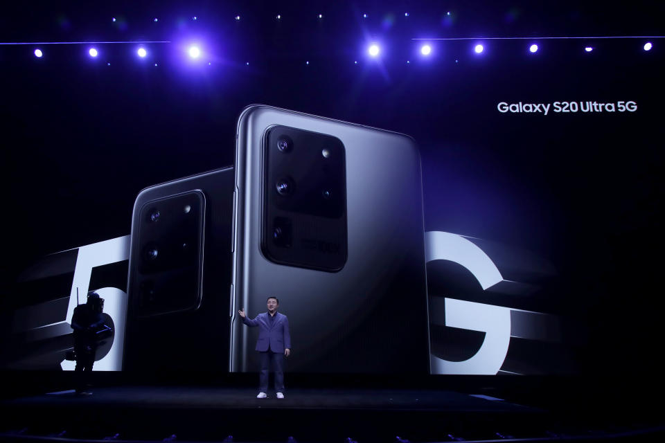 TM Roh, President and Head of Mobile Communications Business, speaks in front of a photo of Samsung Galaxy S20 Ultra 5G phones while speaking at the Unpacked 2020 event in San Francisco, Tuesday, Feb. 11, 2020. (AP Photo/Jeff Chiu)