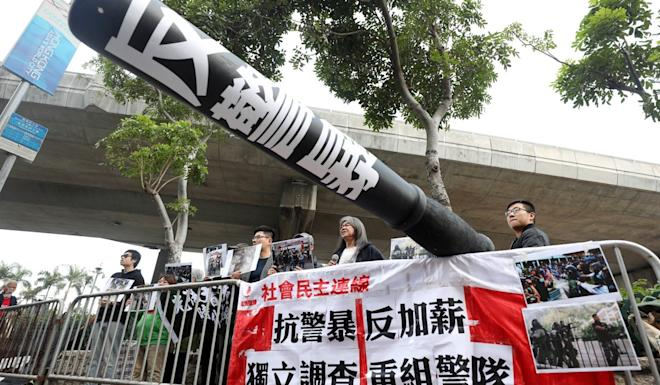 The League of Social Democrats stage a protest as they wait for chief of police Chris Tang. Photo: Xiaomei Chen